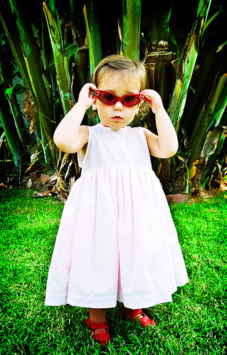 Renesmee playing with sunglasses