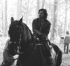Merlin on BBC photo with a horse wrangler called Series 3 Eoin Macken/Sir Gawain