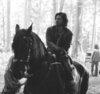 Merlin on BBC photo with a horse wrangler titled Series 3 Eoin Macken/Sir Gawain
