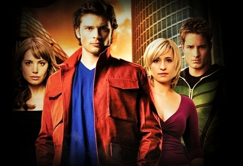 The CW kertas dinding possibly with a well dressed person, an outerwear, and a box kot called Smallville Cast