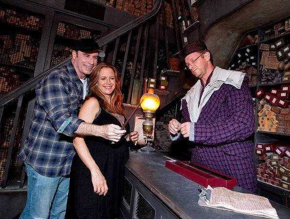 A Very Pregnant Kelly Preston and John Travolta visit The Wizarding World of Harry Potter