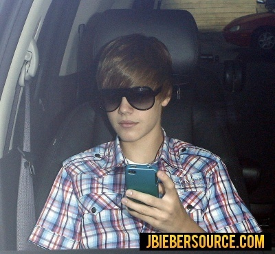 Justin on his phone