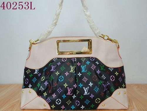Handbags wallpaper with a shoulder bag, an evening bag, and a purse called LV handbags