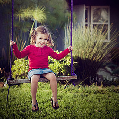 Nessie playing on her swing