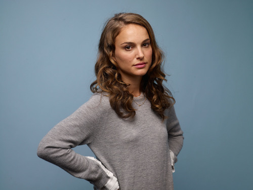 Natalie Portman karatasi la kupamba ukuta probably with a cardigan and a pullover titled Posing for portraits during the 2010 TIFF in Guess Portrait Studio at Regency Hotel