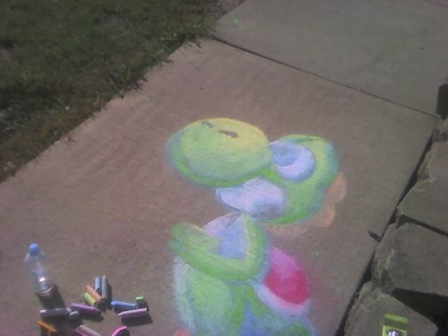 Yoshi drawn on the sidewalk