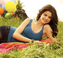 Selena Gomez wallpaper probably containing a barrow called selena cutie♥♥......