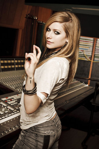 avril lavigne wallpaper probably containing a sign and a synthesizer entitled Avril Lavigne - 2010