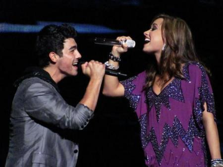 Jemi wallpaper probably with a show, concerto titled Jemi on Tour