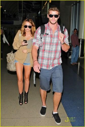 Miley Cyrus & Liam Hemsworth: LAX Landing