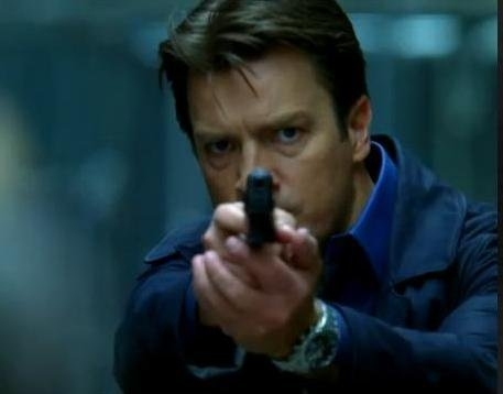 Nathan Fillion fondo de pantalla entitled Nathan /Castle with a gun and a Ball Watch on his wrist.