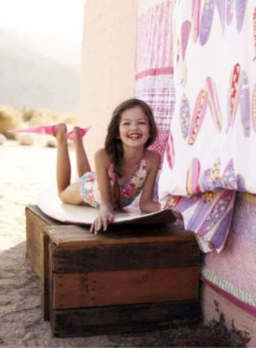 Renesmee playing on a surf board
