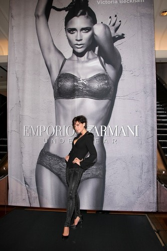 Victoria standing in front of her Emporio Armani Underwear Poster!
