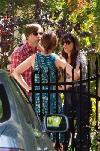 Zooey Deschanel wallpaper probably with a street entitled Zooey at Emily D's nuptial Celebratory Brunch