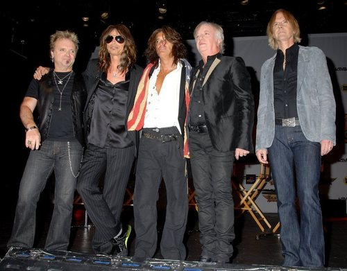 Aerosmith Hintergrund with a business suit, a well dressed person, and a suit titled Aerosmith