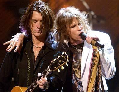 Aerosmith Hintergrund with a guitarist and a konzert called Aerosmith