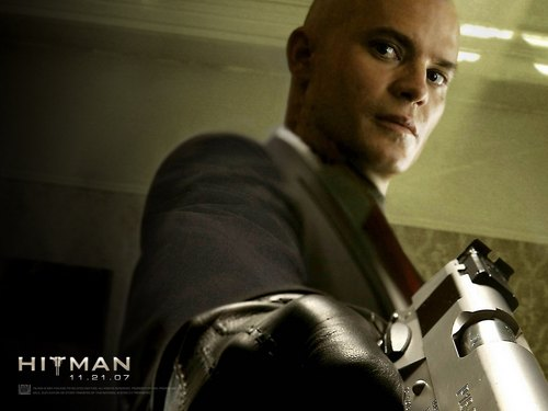 Action Films fondo de pantalla possibly containing a business suit called Hitman