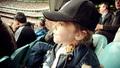 Renesmee wqatchin a baseball game