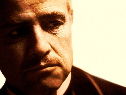 The Godfather Trilogy wallpaper containing a business suit and a suit entitled The Godfather