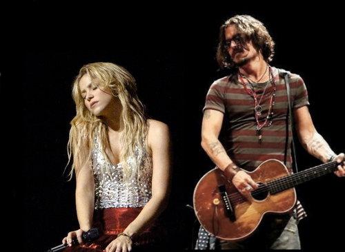 Shakira wallpaper containing a guitarist titled shakira&johnny depp