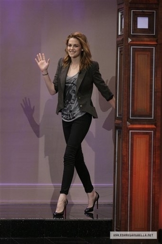 Kristen Stewart wallpaper possibly containing a well dressed person, a hip boot, and a business suit titled 10.08.10: The Tonight Show Jay Leno - Stills