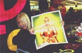 Christina aguilera with an Эминем Poster