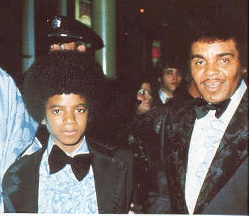 Michael Jackson wallpaper probably with a business suit called Michael at age 14 with Joe Jackson!