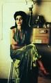 PJ Harvey Seated in a Green Dress - pj-harvey photo