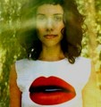 PJ Harvey in a T-shirt with a Mouth - pj-harvey photo
