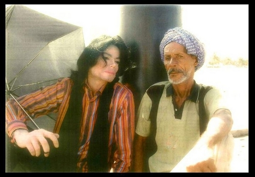 michael sitting with an arabic man in oman
