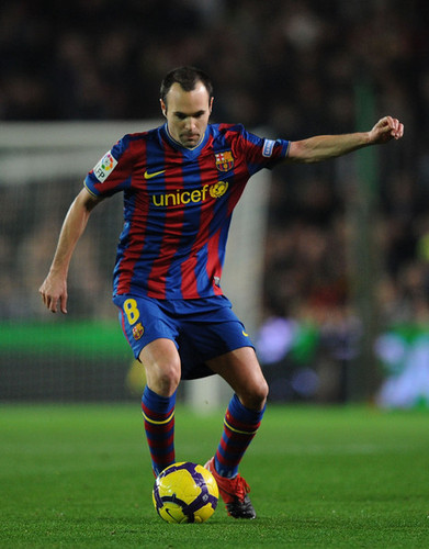 A. Iniesta playing for Barcelona