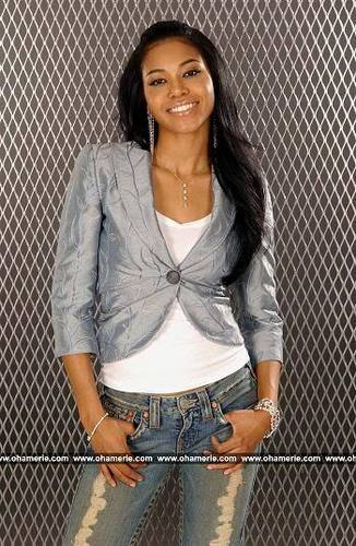 Amerie wallpaper with a chainlink fence and a hip boot titled Amerie