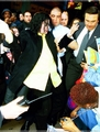 He escorted the old lady to his waiting car and offered her a lift home. - michael-jackson photo