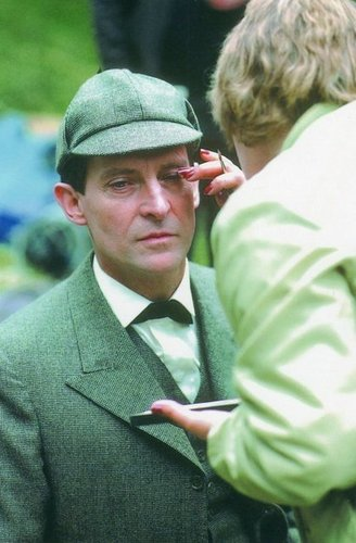 Sherlock Holmes wallpaper containing a business suit called Jeremy Brett aka Sherlock Holmes on set
