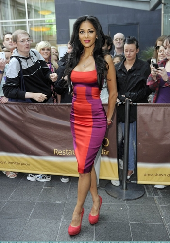 Nicole Scherzinger karatasi la kupamba ukuta probably with a sign, a hip boot, and a playsuit entitled Nicole arriving at the X Factor auditions in Manchester, 7/11/10