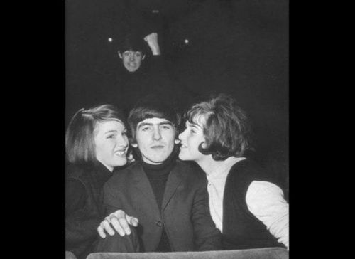 George Harrison and a rather jealous Paul McCartney in the background