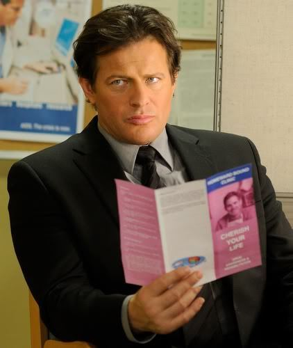 Saw wallpaper with a business suit titled Hoffman