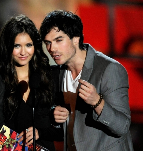 Ian Somerhalder and Nina Dobrev wallpaper probably with a well dressed person and a business suit called Ian & Nina @ Scream Awards 2010
