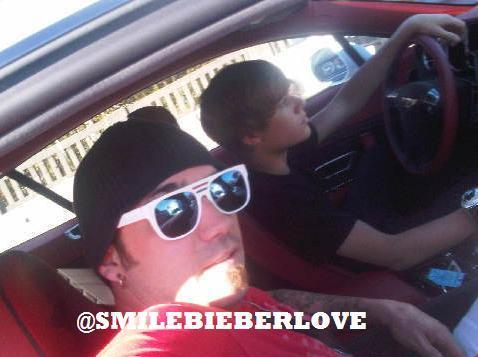 pictures of justin bieber dad. Justin Bieber driving with his