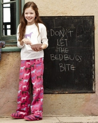 renesmee carlie cullen wallpaper probably with a sign called Mackenzie Foy - Photoshoot