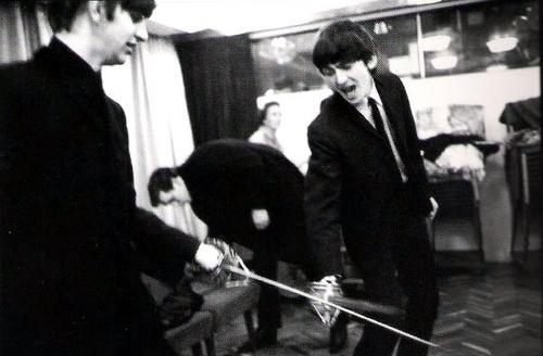 George and Ringo sword fighting!