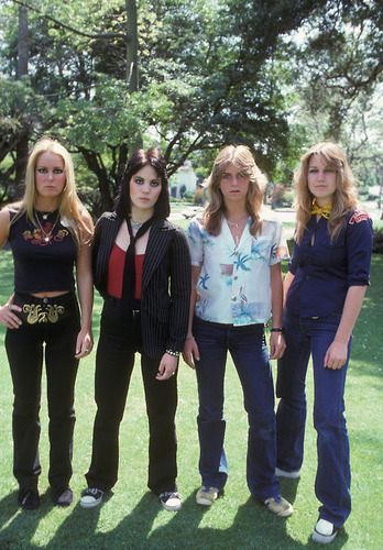 the runaways wallpaper possibly containing a business suit, a well dressed person, and an outerwear called Lita, Joan, Sandy & Vicki