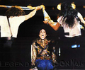 MJ on stage sitting on a chair - michael-jackson photo