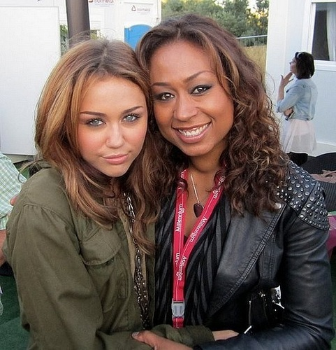 Miley with her backing singer Carmel.
