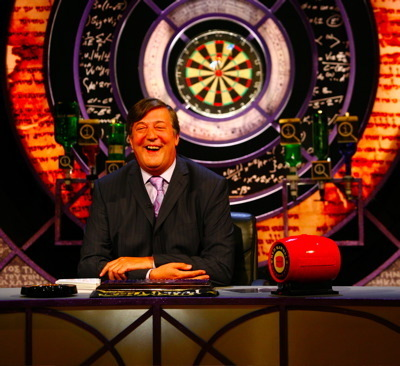 QI wallpaper possibly with a roulette wheel and a business suit titled QI