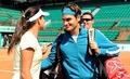 Roger Federer kisses Ana Ivanovic