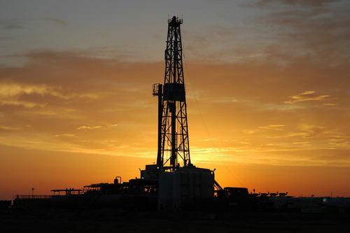 A Drilling rig in the sunset.