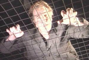 Alan Rickman karatasi la kupamba ukuta containing a chainlink fence and a holding cell titled Alan Rickman