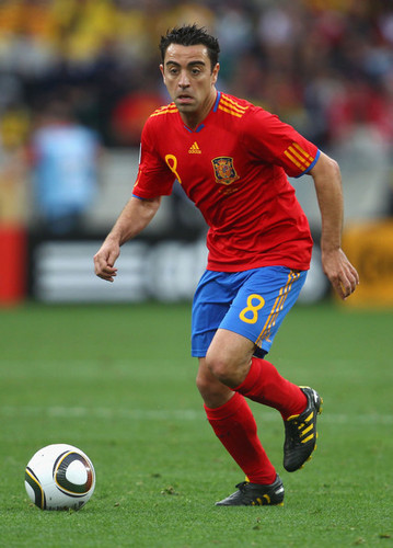Xavi playing for Spain