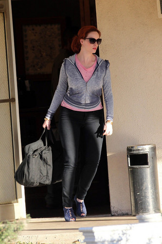 """क्रिसटीना हेंड्रिक्स वॉलपेपर containing sunglasses, a well dressed person, and a business suit titled Christina Hendricks on Set of """"Drive"""""""
